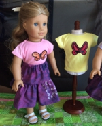 Doll in a t-shirt decorated with butterfly applique