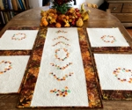 Autumn-themed quilted tablerunner and placemats