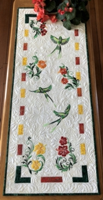 Tropical flowers and birds on a quilted tablerunner