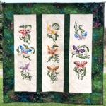 Quilt with 3 vertical rows of butterfly embroidery