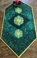 Green Tablerunner with golden Celtic star embroidery.