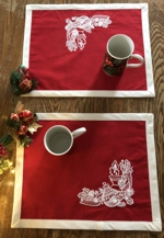 Christmas-themes placemats with embroidery.