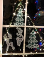 Christmas window hanging with freestanding embroidery.