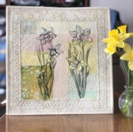 Wall quilt with daffodil embroidery