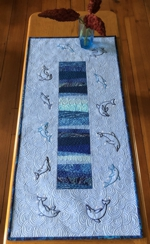 Tablerunner with dolphin embroidery
