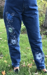 Jeans embellished with flower embroidery