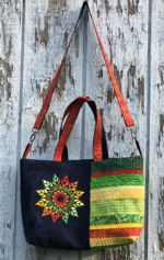 Shoulder bag with fall leaves mandala on the front panel.