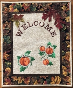 Quilted Welcome sign with pumpkin embroidery