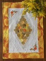 Quilted tablerunner with honeybee embroidery.