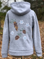 Hoodie with pine cones and snowflakes embroidery