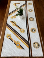 Modern style quilted tablerunner with geometric embroidery