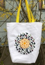 White canvas tote with machine embroidery