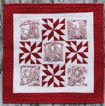 Red-and-White Nativity Wall Quilt with redwork embroidery.
