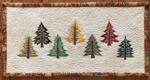 Small wall quilt with pine tree embroidery.