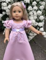A doll in a pink Regency style dress