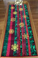 Christmas-themed scrap tablerunner with embroidery