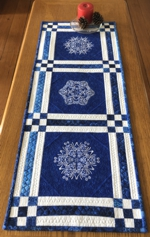 Winter-themed blue tablerunner with snowflake embroidery