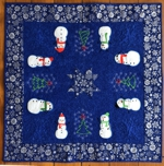 Quilted tabletopper with snowman applique