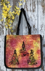 Red and yellow fabric tote with black eembroidery