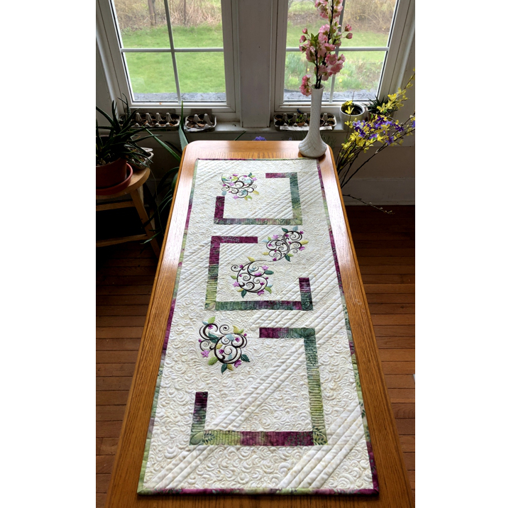 Quilted tablerunner with floral machine embroidery