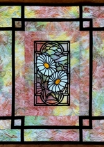 Close-up of the stained glass flower panel wall quilt