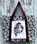 Tote bag with embroidery of a young woman on the front pocket.