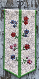 Quilted Wallhanging with spring flower embroidery.