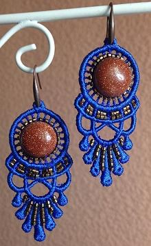 Photo of a set of embroidered earrings.