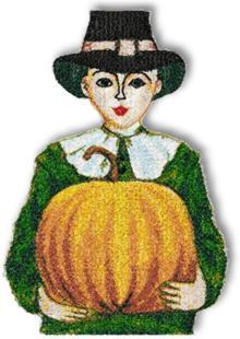 Pilgrim boy woth a pumpkin.