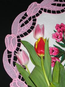 Photo of a doily with freestanding tulip border.