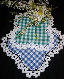 Photo of doilies with embroidered lace borders.