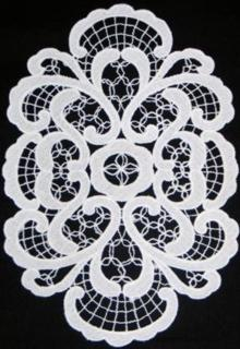 Photo of a freestaning lace doily stitch-out.