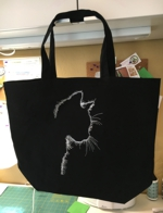 Black tote with cat silhouette embroidery.