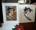 A portrait of a lady embroidered on balsa wood