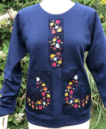 Sweat shirt decorated with leaf embroidery