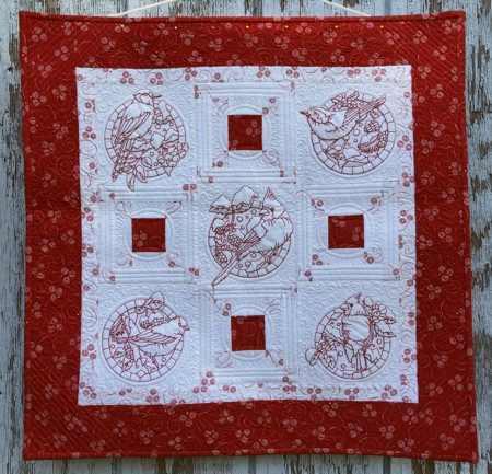 ed-and-White Christmas Wall Quilt with Winter Bird Embroidery