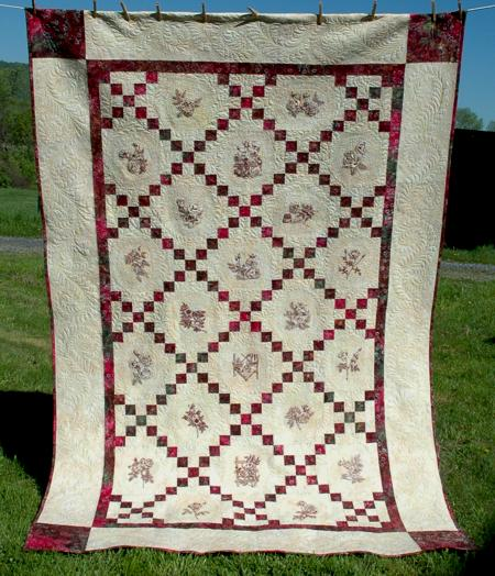 Single irish chain bed quilt with rose redwork embroidery for Bed quilting designs